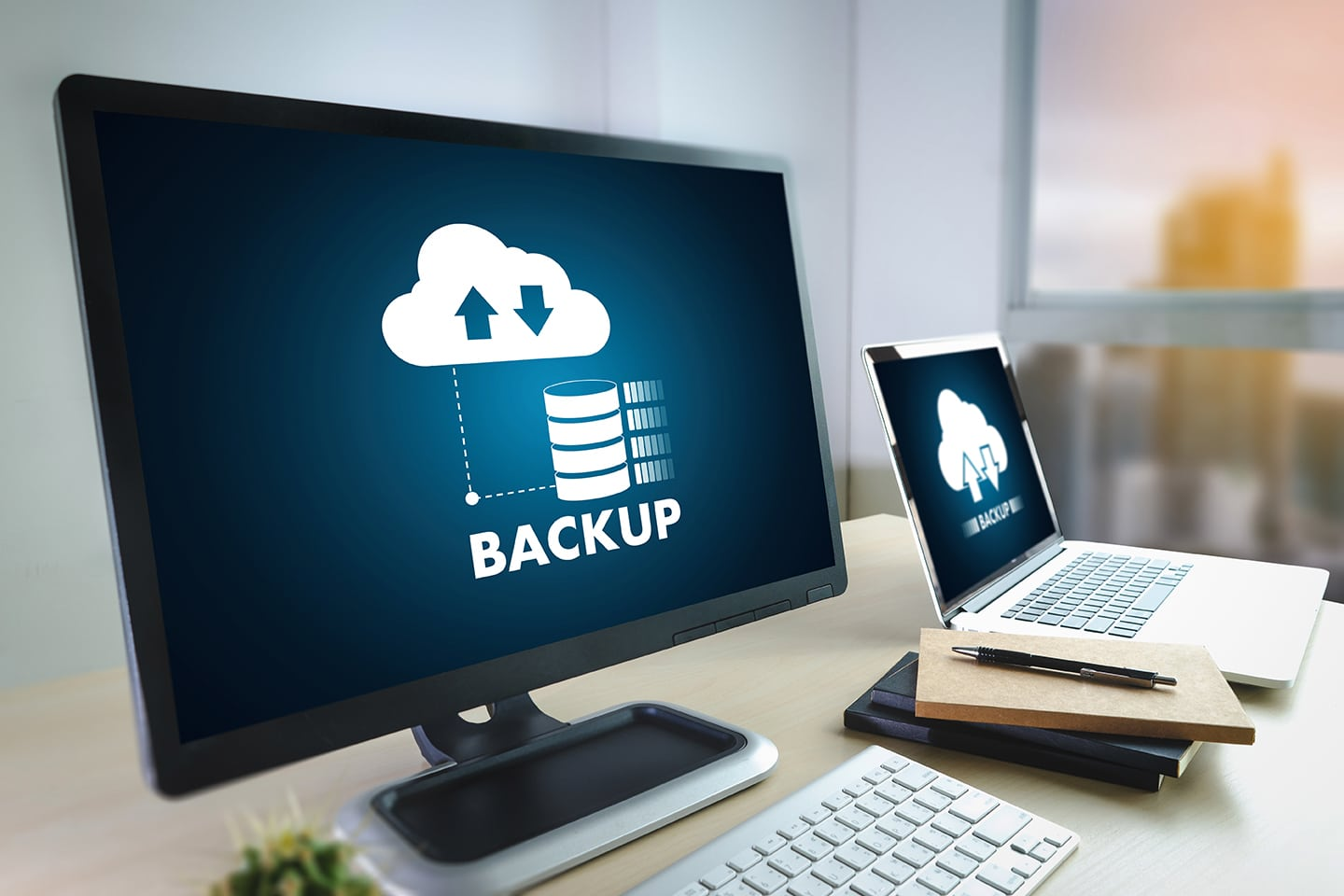 data backup being performed on desktop computer and laptop